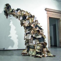 Daniele Girardi, What remains, 2014, installazione site-specific: Moleskine, cenere, legno, ferro, dimensioni variabili